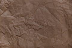Falte des braunen Papiers masert die Hintergründe für Design, dekorativ lizenzfreie stockfotografie