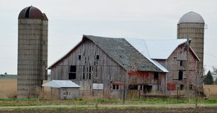 Faltering Farm. This is a Spring picture of abandoned farm buildings off Interstate 90 in Einnebago County, Illinois.  This picture was taken on April 29, 2015 Stock Photos