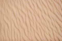 falujące tekstury piasku Zdjęcia Stock