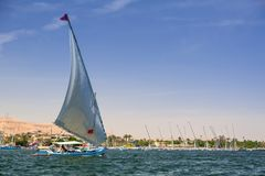 Felucca sailboat on the Nile river. Falukas sailboat on the Nile river near Luxor, Egypt Stock Photo