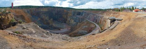 Falun copper mine. The enormous mining excavation known as the Great Pit at Falun is the most striking feature of a landscape that illustrates the activity of Royalty Free Stock Photography