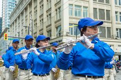 May 12, 2019 - Vancouver, Canada: Falun Dafa members in parade through streets of downtown on Mother`s Day 2019. Falun Dafa, also known as Falun Gong royalty free stock photography