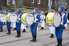Falun Dafa marching band at the Beaches Easter Parade 2017 on Qu Stock Photography