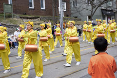 Falun Dafa marching group dressed in traditional Chinese costume Royalty Free Stock Photos