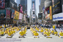 Falun Gong assemble in Times Square. Members of Falun Gong, or Falun Dafa, assemble in Times Square, New York City, and strike a harmonious meditative pose royalty free stock photos