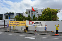 Falun Gong movement  protest. AUCKLAND - JAN 09 2015:Falun Gong movement  protest outside the Chines Embassy. It claimed since 2000 almost 40,000 transplants Stock Images