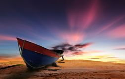 Faluwa boat during sunset with moving clouds Stock Image