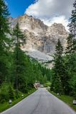 Falzarego pass straight road, Dolomite Alps, Italy. Wide angle vertical view of straight road in Falzarego pass, Dolomite Alps, Italy Stock Photos