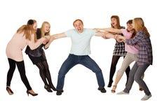 Família alegre que tem o divertimento no branco Fotografia de Stock Royalty Free