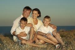 Família amigável no branco Foto de Stock