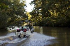 A família aprecia um passeio no barco da velocidade fotografia de stock royalty free