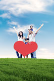 Família asiática feliz no prado Imagens de Stock Royalty Free