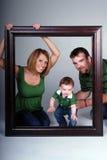 Família através do frame. Fotos de Stock Royalty Free