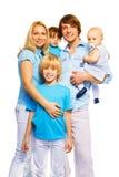 Família bonita com 3 crianças Imagem de Stock Royalty Free