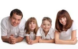 Família bonita com duas crianças Fotografia de Stock Royalty Free