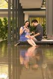 Família chinesa asiática nova com filho do bebê de cinco meses Fotografia de Stock Royalty Free