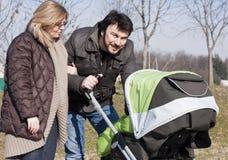 Família com carrinho de criança Foto de Stock Royalty Free