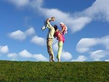 Família com duas crianças Foto de Stock Royalty Free