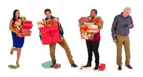 Família com muitos presentes de Natal imagens de stock