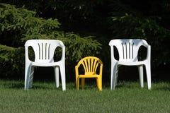 Família das cadeiras Fotografia de Stock