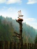 Família de madeira das cegonhas Fotos de Stock Royalty Free