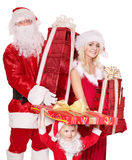 Família de Papai Noel com a caixa de presente da terra arrendada da criança. Imagens de Stock Royalty Free