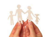 Família de papel nas mãos Fotos de Stock Royalty Free