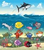 Família de peixes engraçados sob o mar. Imagens de Stock