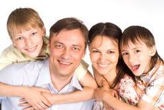 Família de uns quatro foto de stock