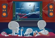 A família dos esqueletos está prestando atenção à tevê Fotografia de Stock