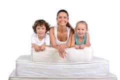 Família e muitos colchões Fotos de Stock Royalty Free