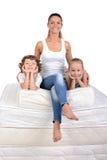 Família e muitos colchões Fotografia de Stock Royalty Free