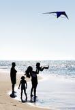 Família e um papagaio Fotos de Stock Royalty Free