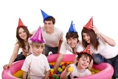 Família feliz, aniversário das crianças. Foto de Stock