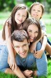 Família feliz ao ar livre Foto de Stock