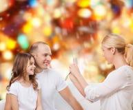 Família feliz com câmera em casa Fotografia de Stock