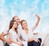 Família feliz com câmera em casa Fotos de Stock