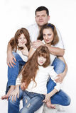 Família feliz com duas crianças Fotos de Stock Royalty Free