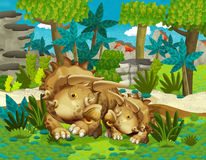 Família feliz dos desenhos animados da ilustração dos triceratopses dos dinossauros para crianças Foto de Stock