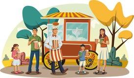 Família feliz dos desenhos animados que come a pipoca Fotografia de Stock Royalty Free