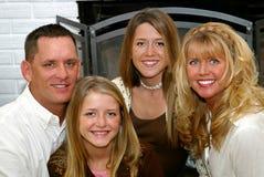 Família feliz em casa Fotos de Stock Royalty Free