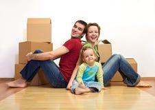 Família feliz em sua HOME nova imagens de stock royalty free