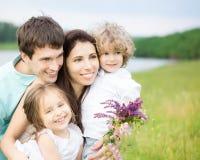 Família feliz fora fotografia de stock royalty free