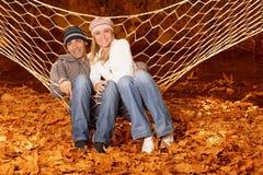 Família feliz no hammock Fotos de Stock Royalty Free
