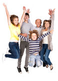 Família feliz que salta altamente Foto de Stock Royalty Free