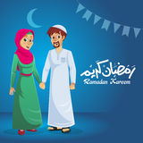 Família muçulmana feliz no fundo azul Foto de Stock Royalty Free