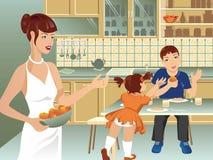 Família na cozinha Fotos de Stock Royalty Free