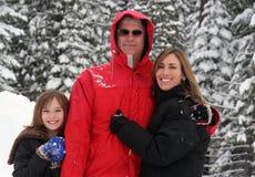 Família na neve Fotos de Stock Royalty Free