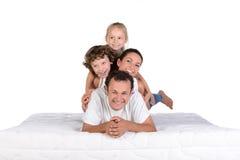 Família no colchão Imagens de Stock