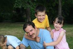 Família no parque Foto de Stock Royalty Free